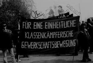 Schaumberg mit Transparent: Für eine klassenkämpferische Gewerkschaftsbewegung